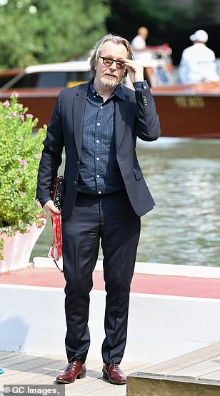 Gary Oldman was looking dapper as he arrived at the Venice International Film Festival.