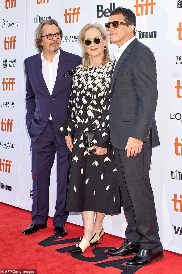"Gary Oldman and ""The Laundromat"" costars Meryl Streep and Antonio Banderas chat on the red carpet at the Toronto International Film Festival."