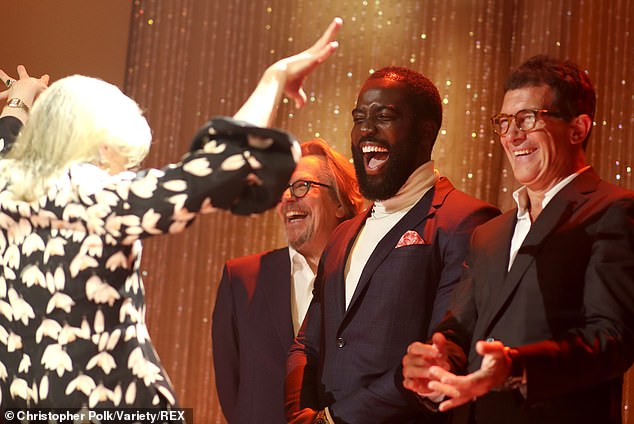 Gary Oldman, Shamier Anderson, and Antonio Banderas greet Meryl Streep at the Toronto International Film Festival.