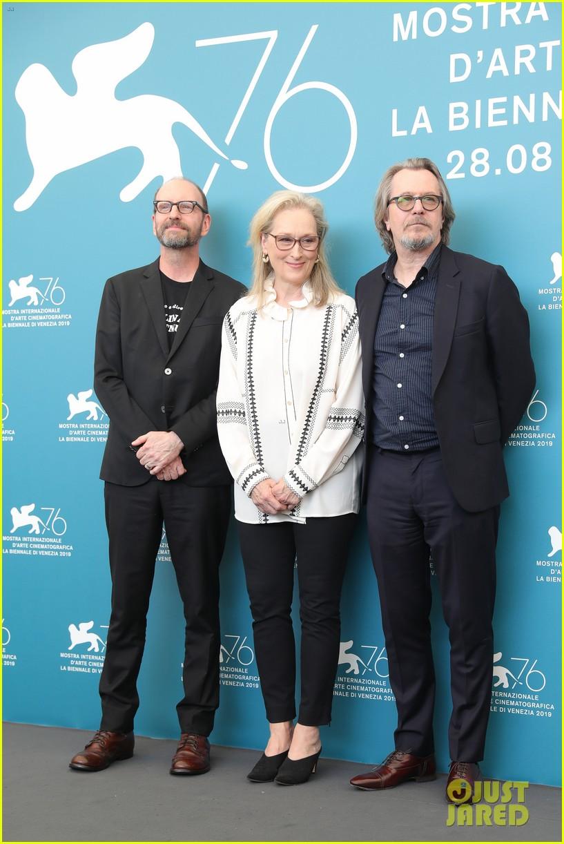 "Gary Oldman poses with ""The Laundromat"" costar Meryl Streep and director Steven Soderbergh at the Venice International Film Festival."