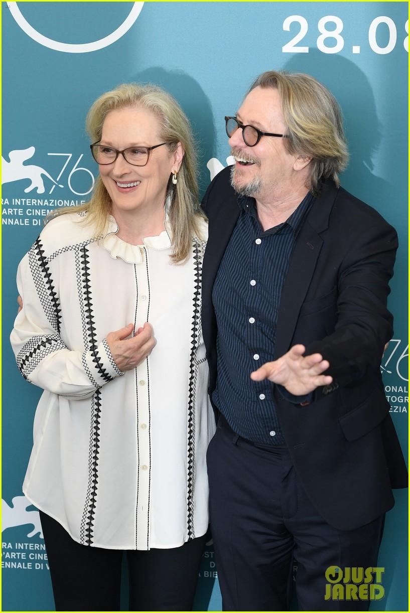 "Gary Oldman shares a laugh with ""The Laundromat"" costar Meryl Streep at the Venice International Film Festival."