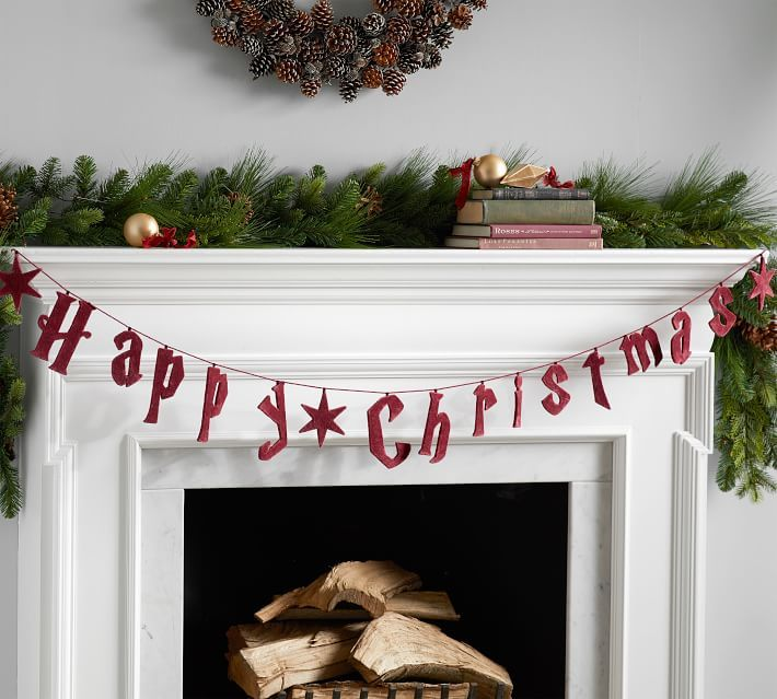 """This garland takes the iconic """"Harry Potter"""" font and uses it to display a festive message."""