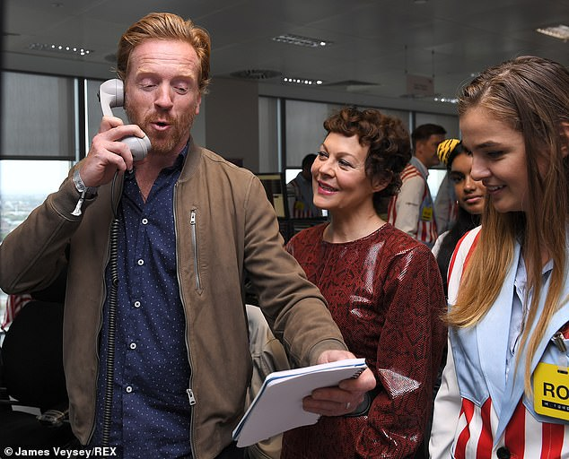 Helen McCrory looks on as husband Damian Lewis takes a call at BGC Charity Day.