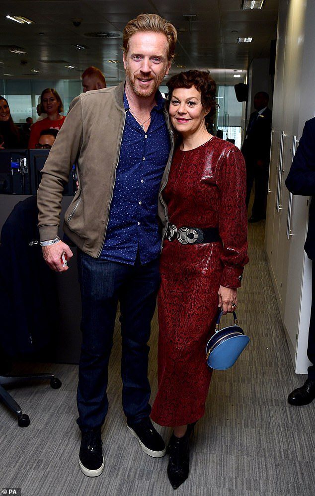 Helen McCrory and husband Damian Lewis pose for a photo at BGC Charity Day.