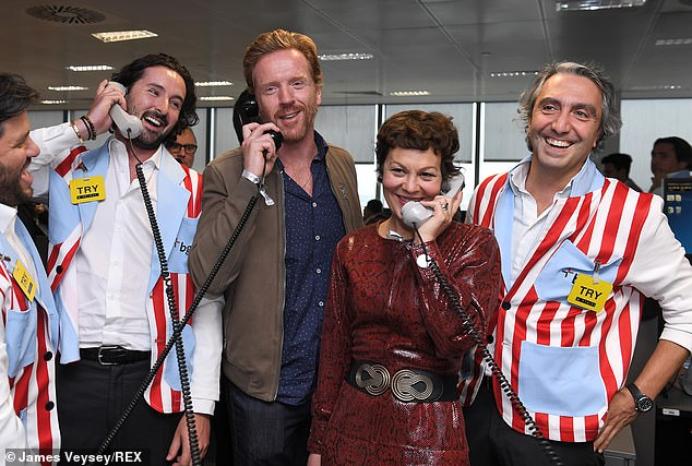 Helen McCrory and husband Damian Lewis field fundraising calls at BGC Charity Day.