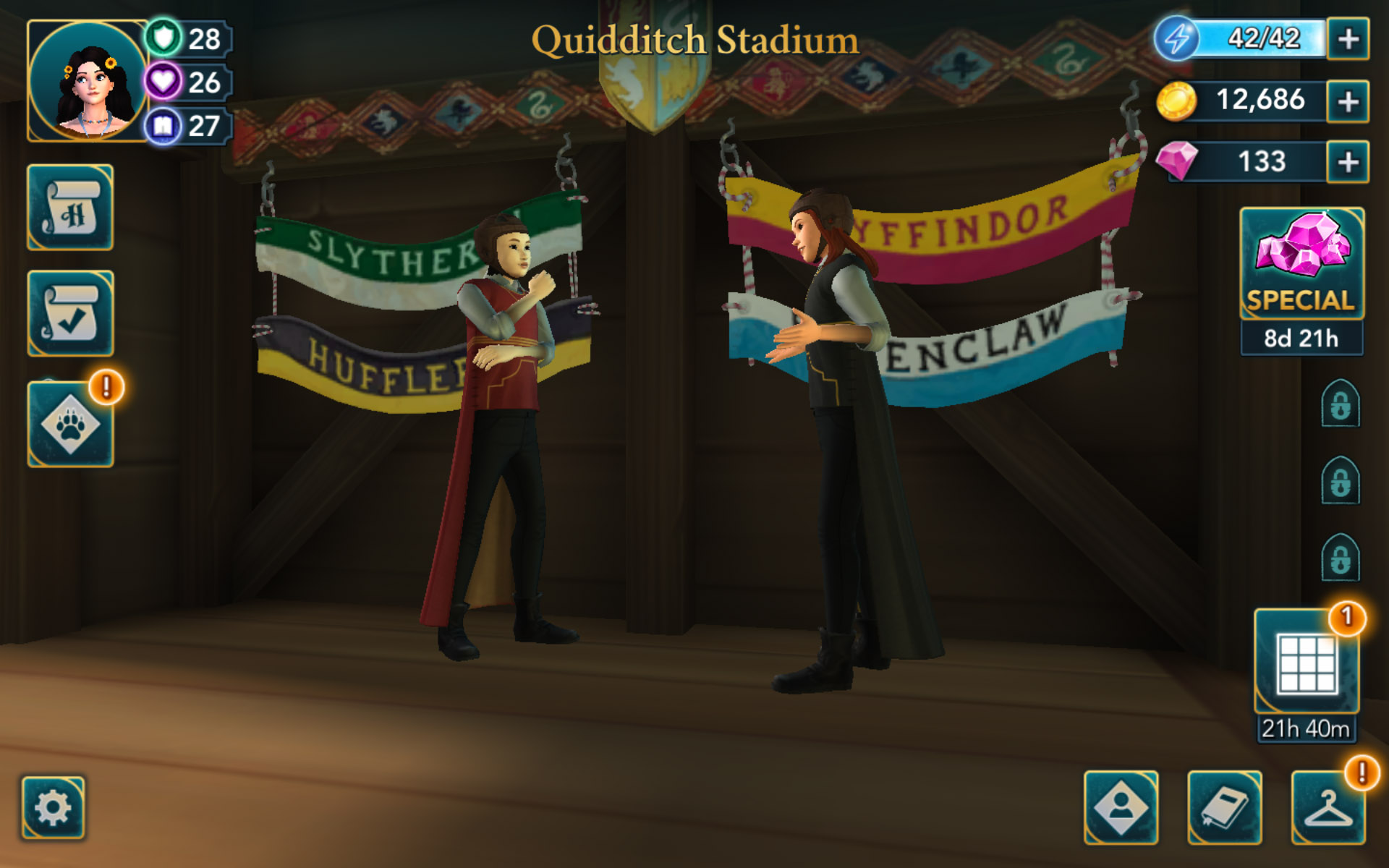 """A view of the House banners at the Quidditch Stadium is seen in this screenshot from """"Harry Potter: Hogwarts Mystery""""."""