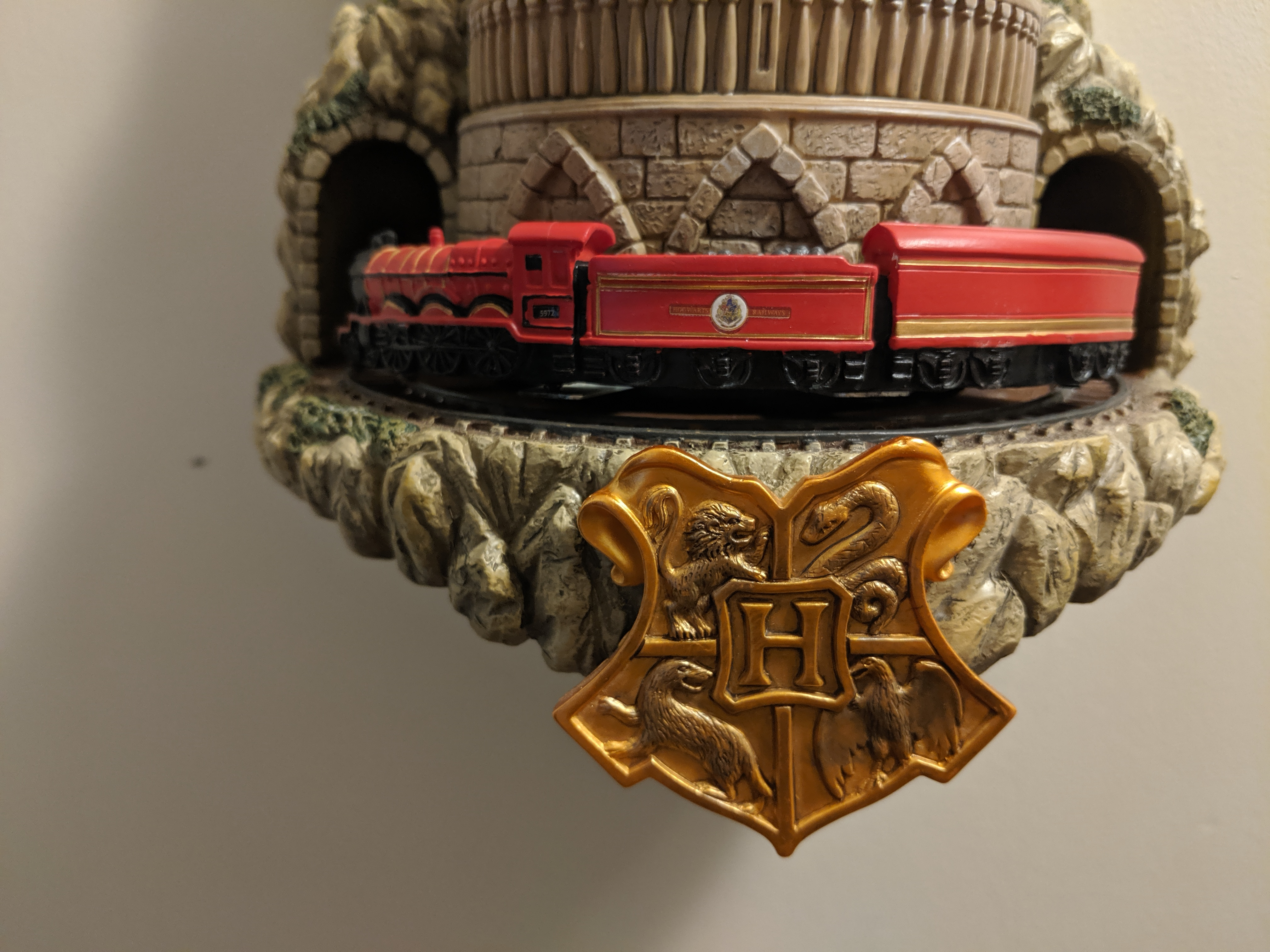 The Hogwarts Express and crest on the wall clock