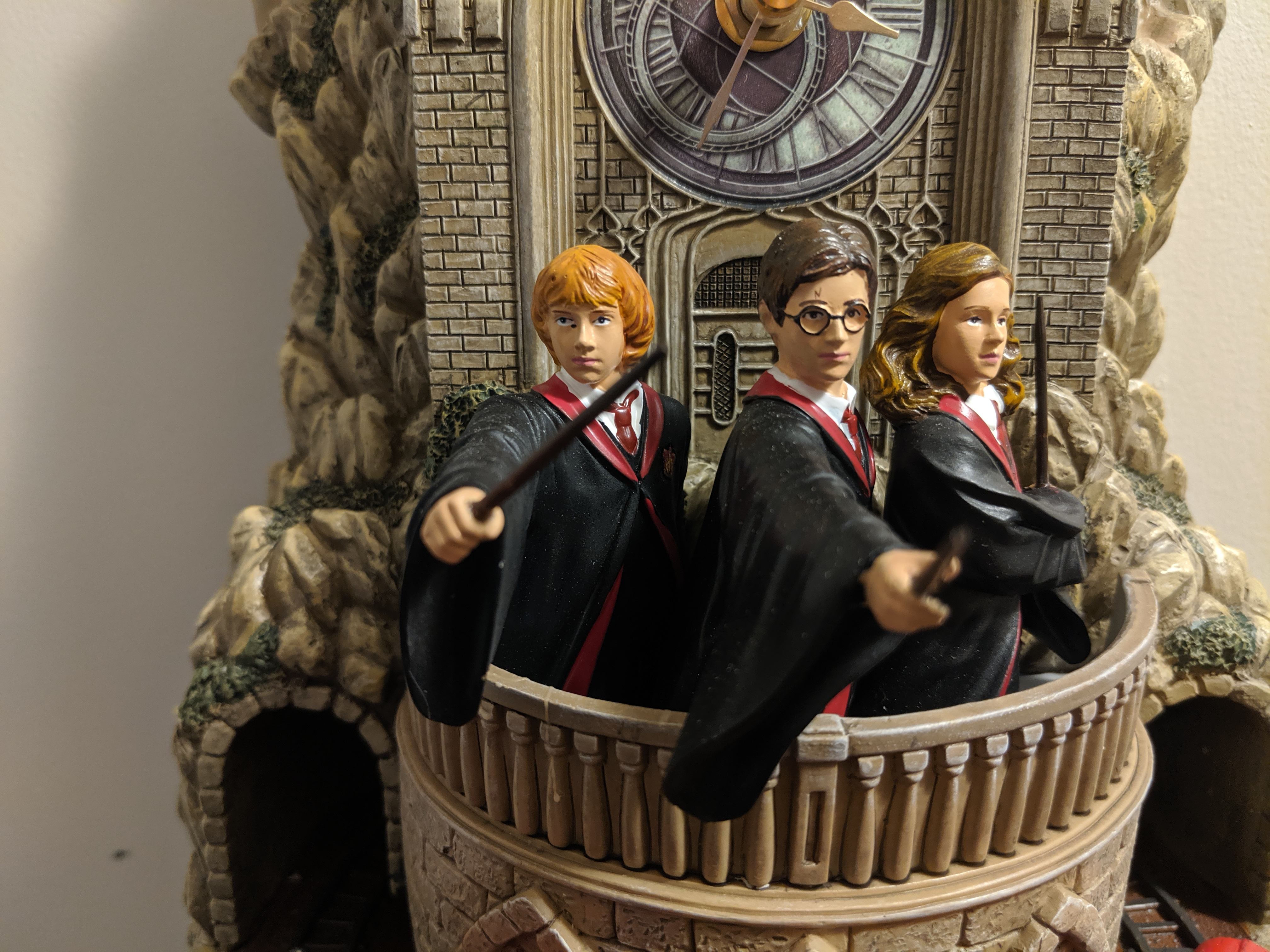 The wonderfully detailed Ron, Harry, and Hermione with wands at the ready