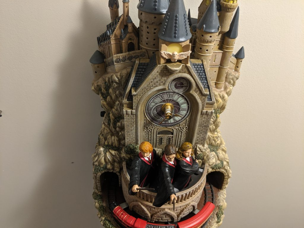 The Hogwarts wall clock features Harry, Ron, Hermione, and the Hogwarts Express