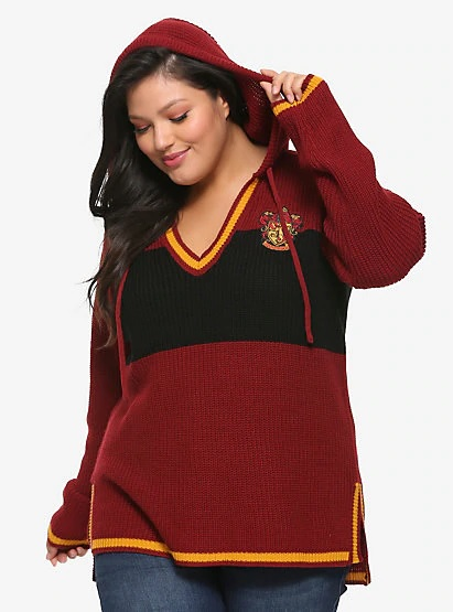 A model shows off the drawstring hood on her Gryffindor sweater from Hot Topic.