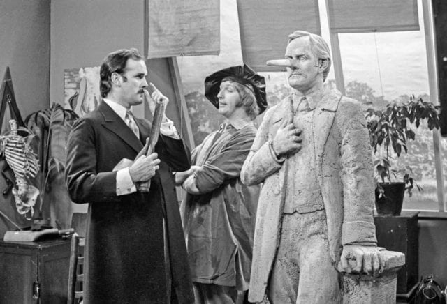 "John Cleese, left. is pictured in a still from a ""Monty Python's Flying Circus"" sketch."
