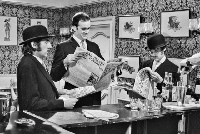 """John Cleese, center. is pictured in a still from a """"Monty Python's Flying Circus"""" sketch."""
