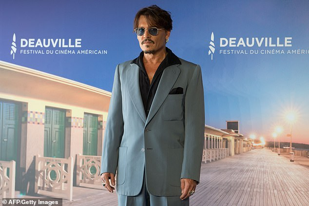 "Johnny Depp looks cool as ever during a photocall for ""Waiting for the Barbarians"" at the Deauville American Film Festival in France."