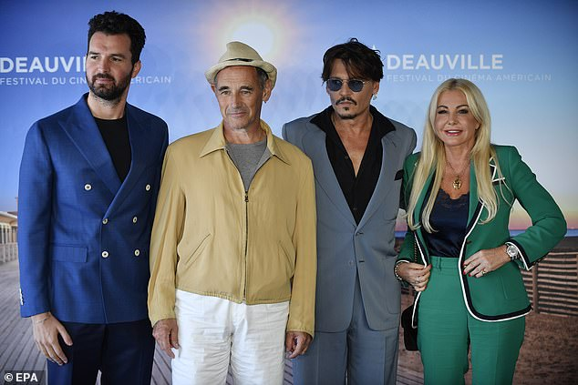 "Johnny Depp poses with ""Waiting for the Barbarians"" producers Andrea Iervolino, far left, and Monika Bacardi, far right, and costar Sir Mark Rylance at the Deauville American Film Festival in France."