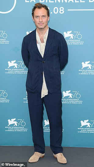 """Jude Law looks stylish during a photo call for """"The New Pope"""" at the Venice International Film Festival."""