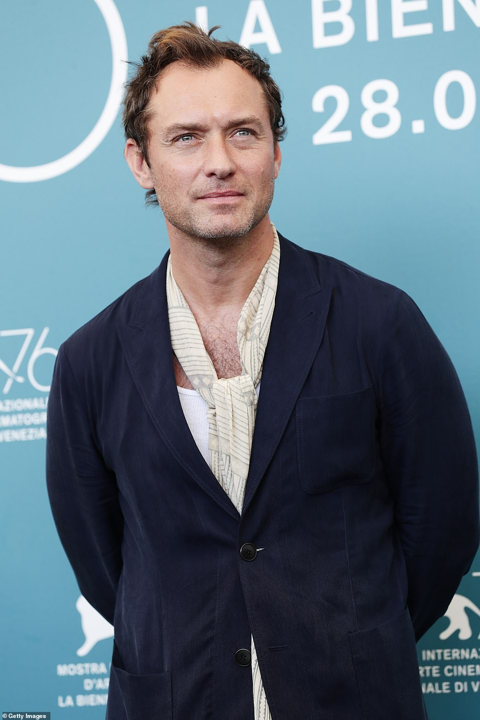 """Jude Law poses during a photo call for """"The New Pope"""" at the Venice International Film Festival."""