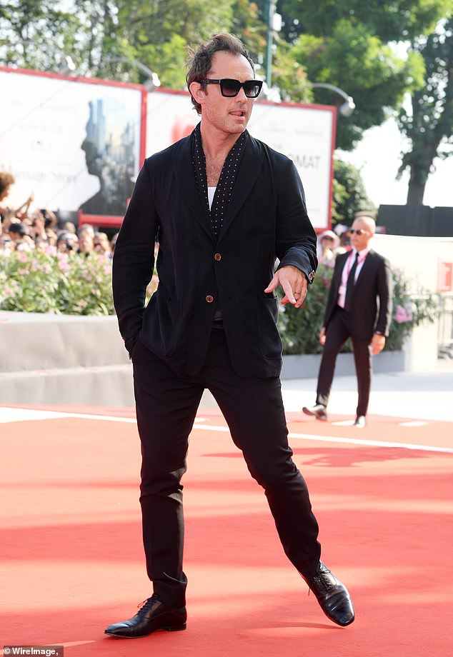 Jude Law strikes a devastating pose on the red carpet at the Venice International Film Festival.