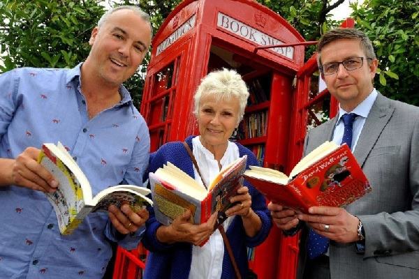 Dame Julie Walters poses during the opening of a children's book-swap library in England.