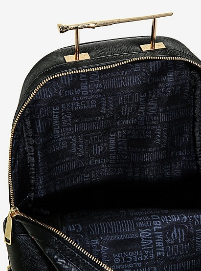 "Pictured is a look at the interior of the ""Harry Potter"" wand handle backpack from Loungefly."