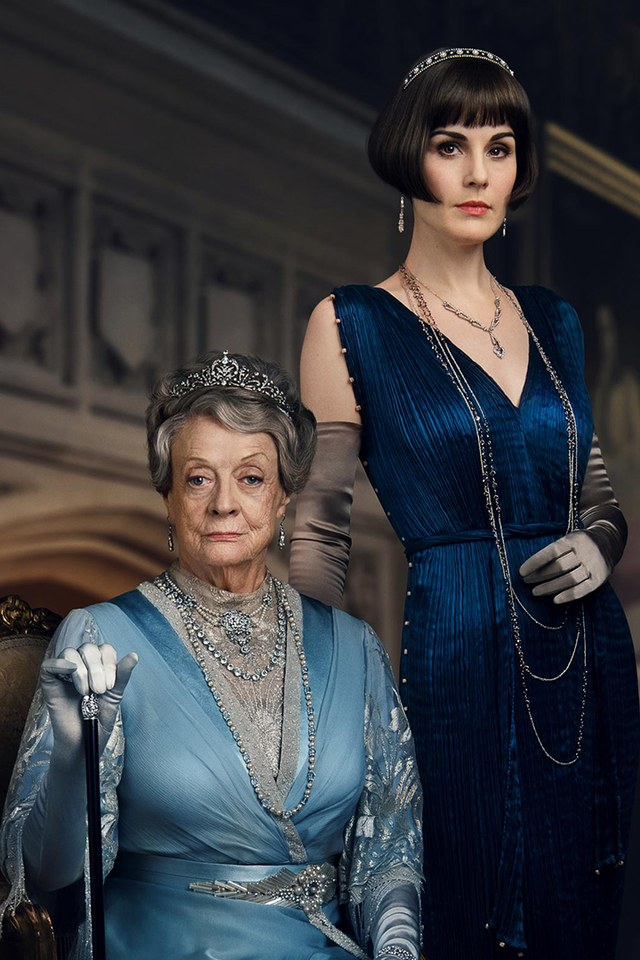 "Maggie Smith and Michelle Dockery pose wearing two of the antique tiaras that will be featured in ""Downton Abbey""."