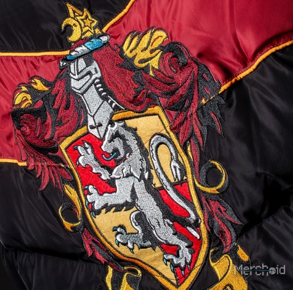 The House crests on the backs and chests of these padded jackets are beautifully embroidered.