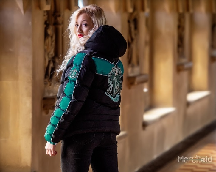 A model shows off the Slytherin padded jacket from Merchoid.
