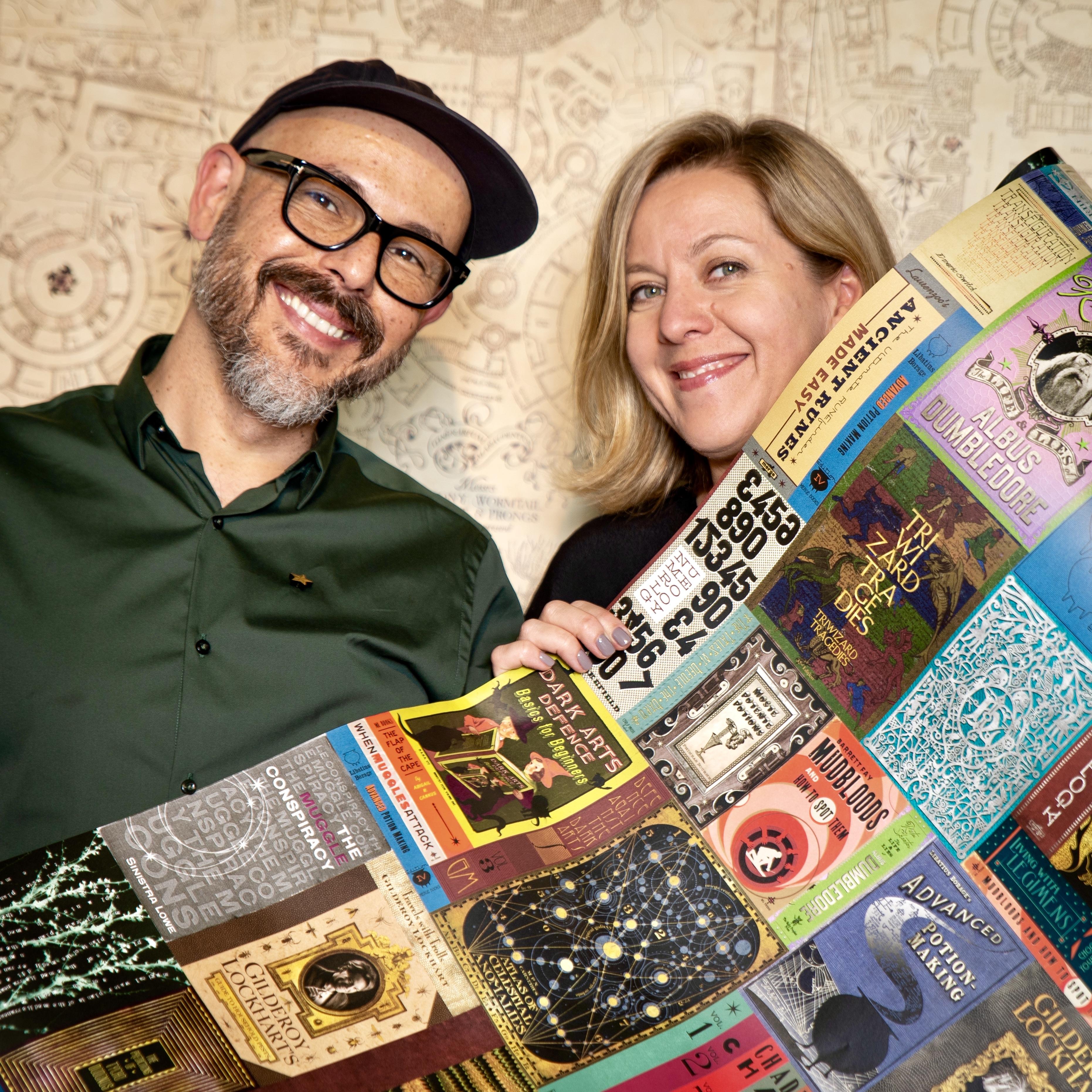 Designers Miraphora Mina and Eduardo Lima show off their wizarding book wallpaper design.