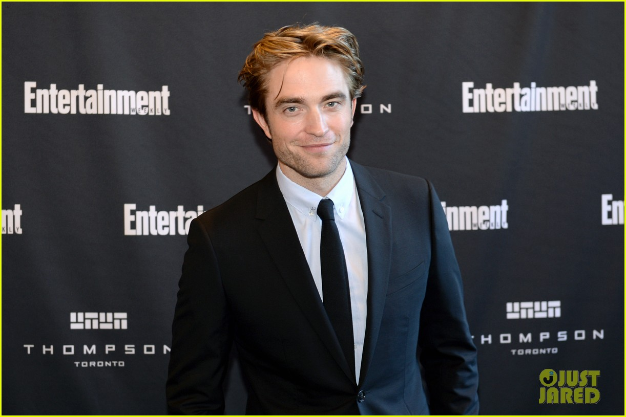 Robert Pattinson smiles for the camera at the Toronto International Film Festival.