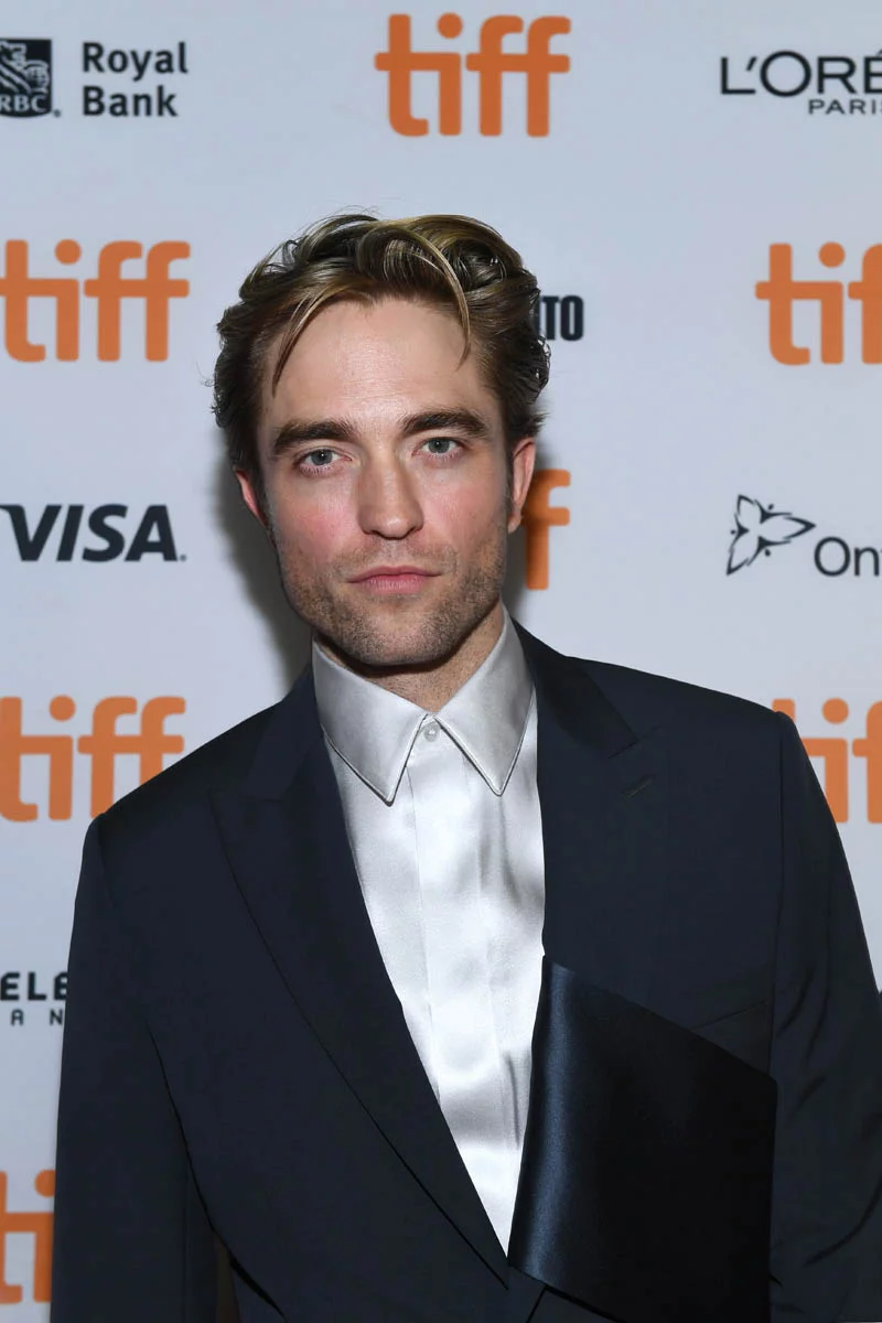 Robert Pattinson poses on the red carpet at the Toronto International Film Festival.