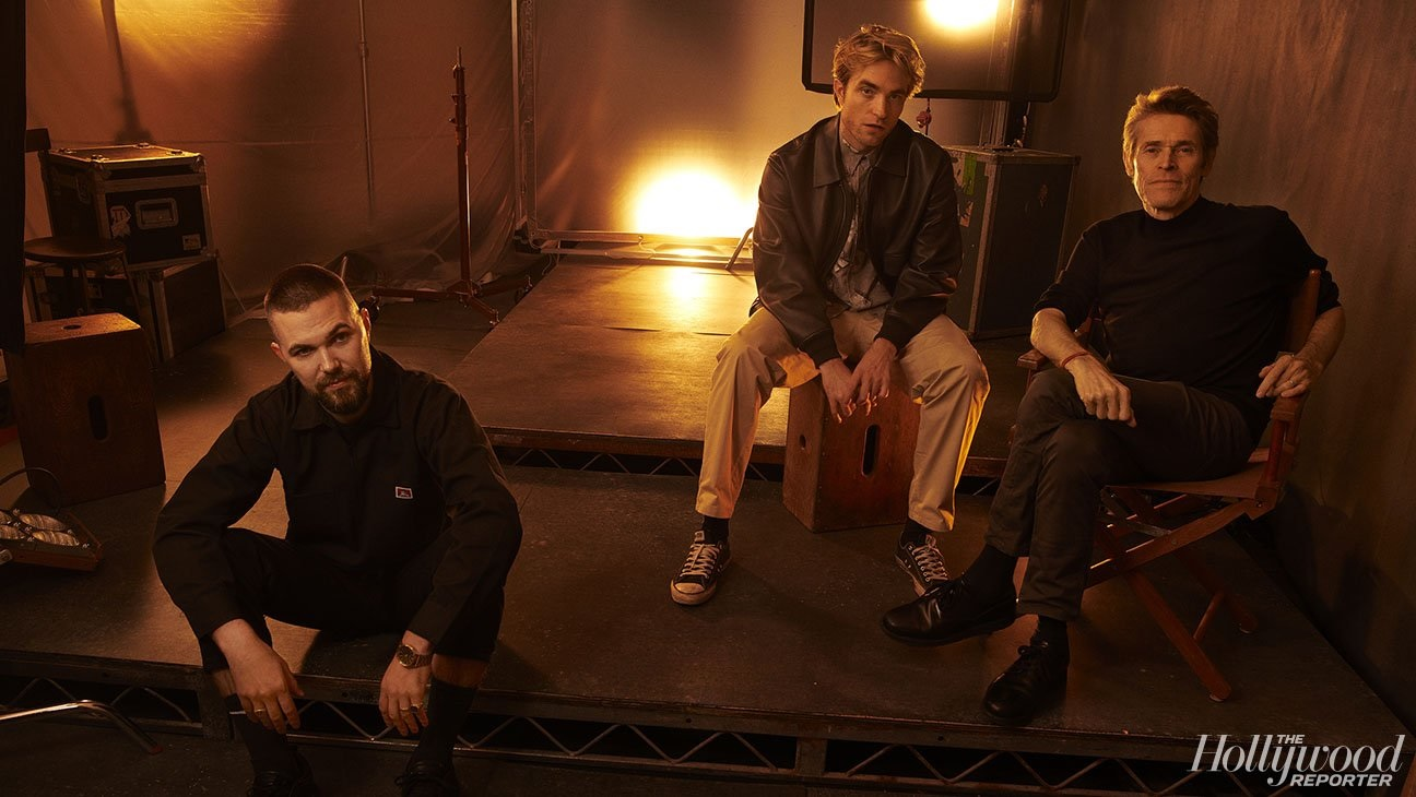 """Robert Pattinson poses for a portrait at the Toronto International Film Festival with """"The Lighthouse"""" costar Willem Dafoe and director Robert Eggers."""