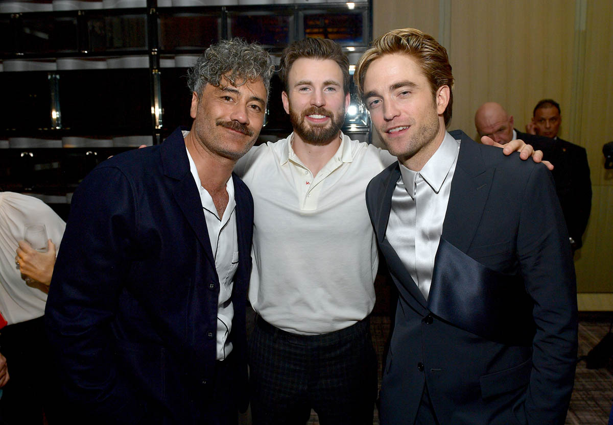 Robert Pattinson poses at the Toronto International Film Festival with Taika Waititi and Chris Evans.