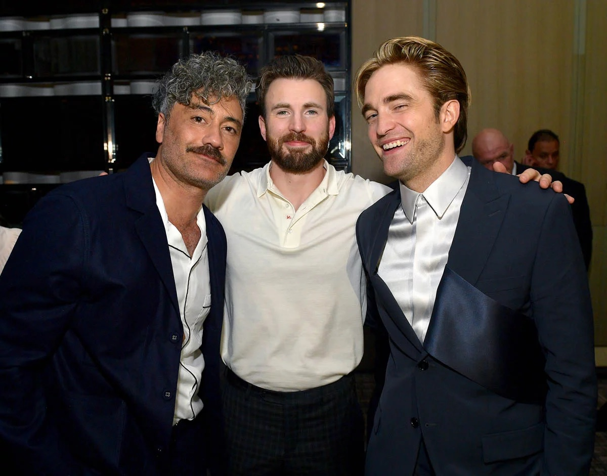 Robert Pattinson shares a laugh at the Toronto International Film Festival with Taika Waititi and Chris Evans.
