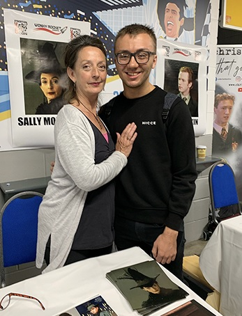 Sally Mortemore poses with a fan at Preston Comic Con.