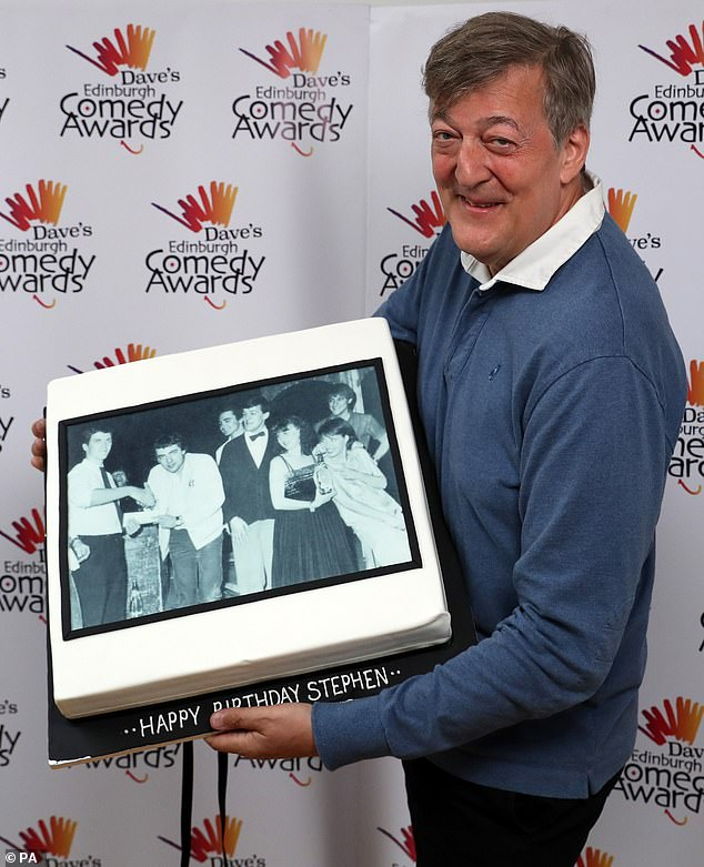 Stephen Fry shows off his birthday cake, featuring a 1981 photo that includes himself and Dame Emma Thompson, during the Dave's Edinburgh Comedy Awards at Edinburgh Festival Fringe.