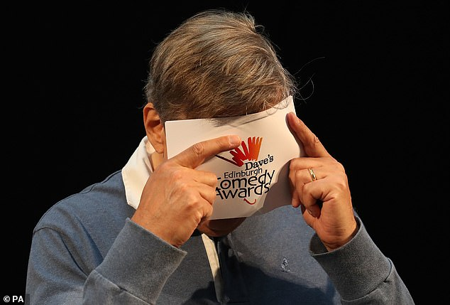 """Stephen Fry is overcome with emotion as the crowd sings """"Happy Birthday"""" during Edinburgh Festival Fringe."""