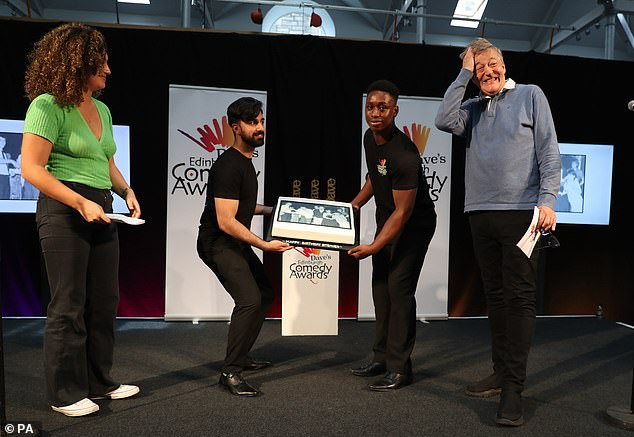 Stephen Fry is surprised with a birthday cake at Edinburgh Festival Fringe.