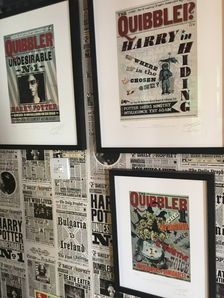 "The ""Daily Prophet"" wallpaper is being used as a backdrop for prints of ""The Quibbler"""