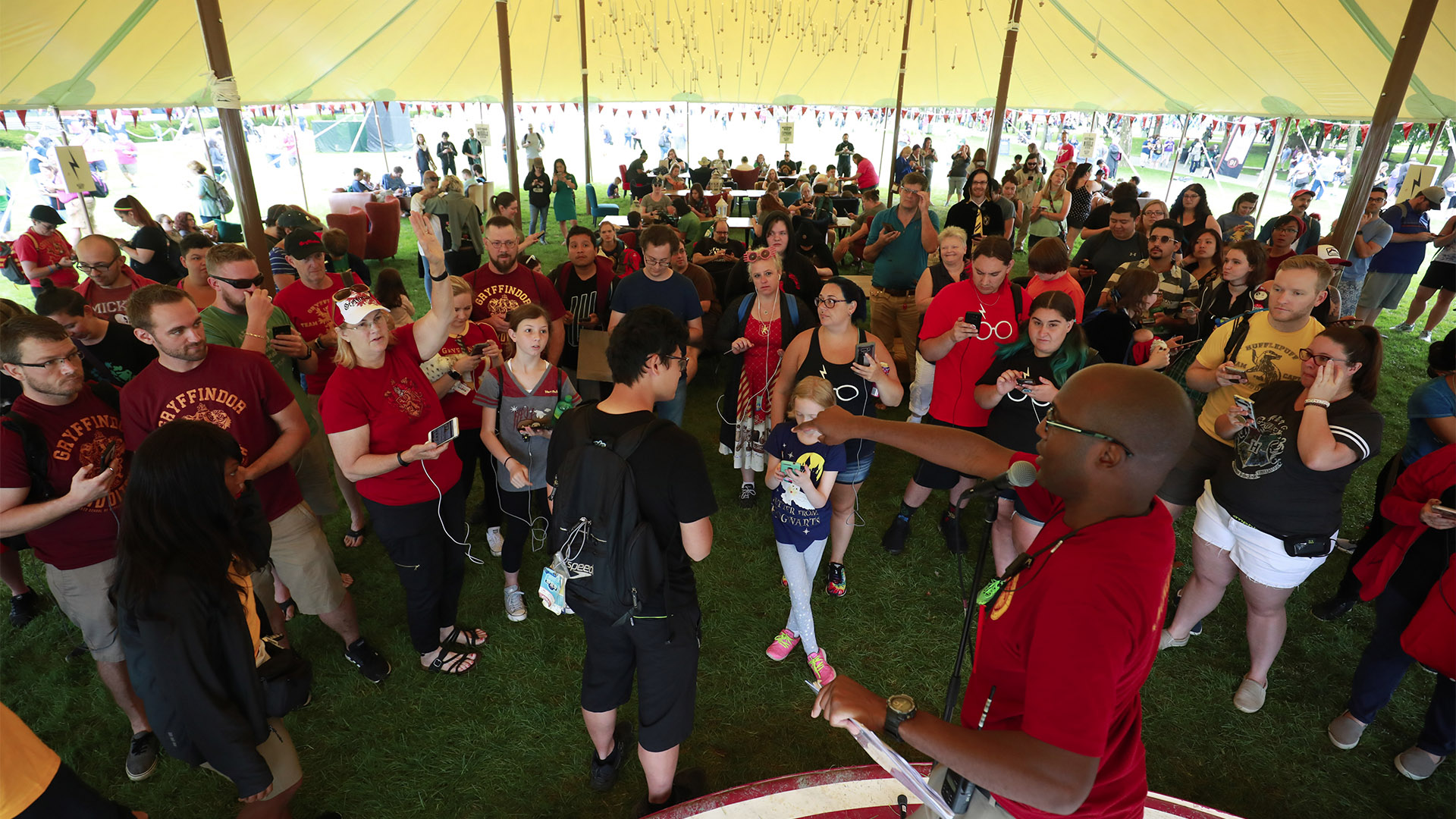 """Gamers at the """"Harry Potter: Wizards Unite"""" Fan Festival compete in trivia contests to earn prizes."""