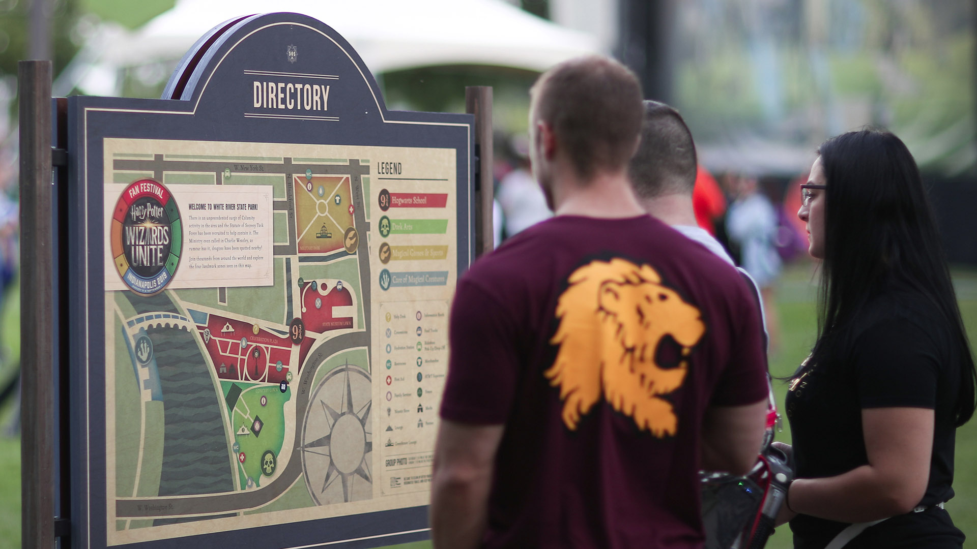 """Gamers at the """"Harry Potter: Wizards Unite"""" Fan Festival check the map."""