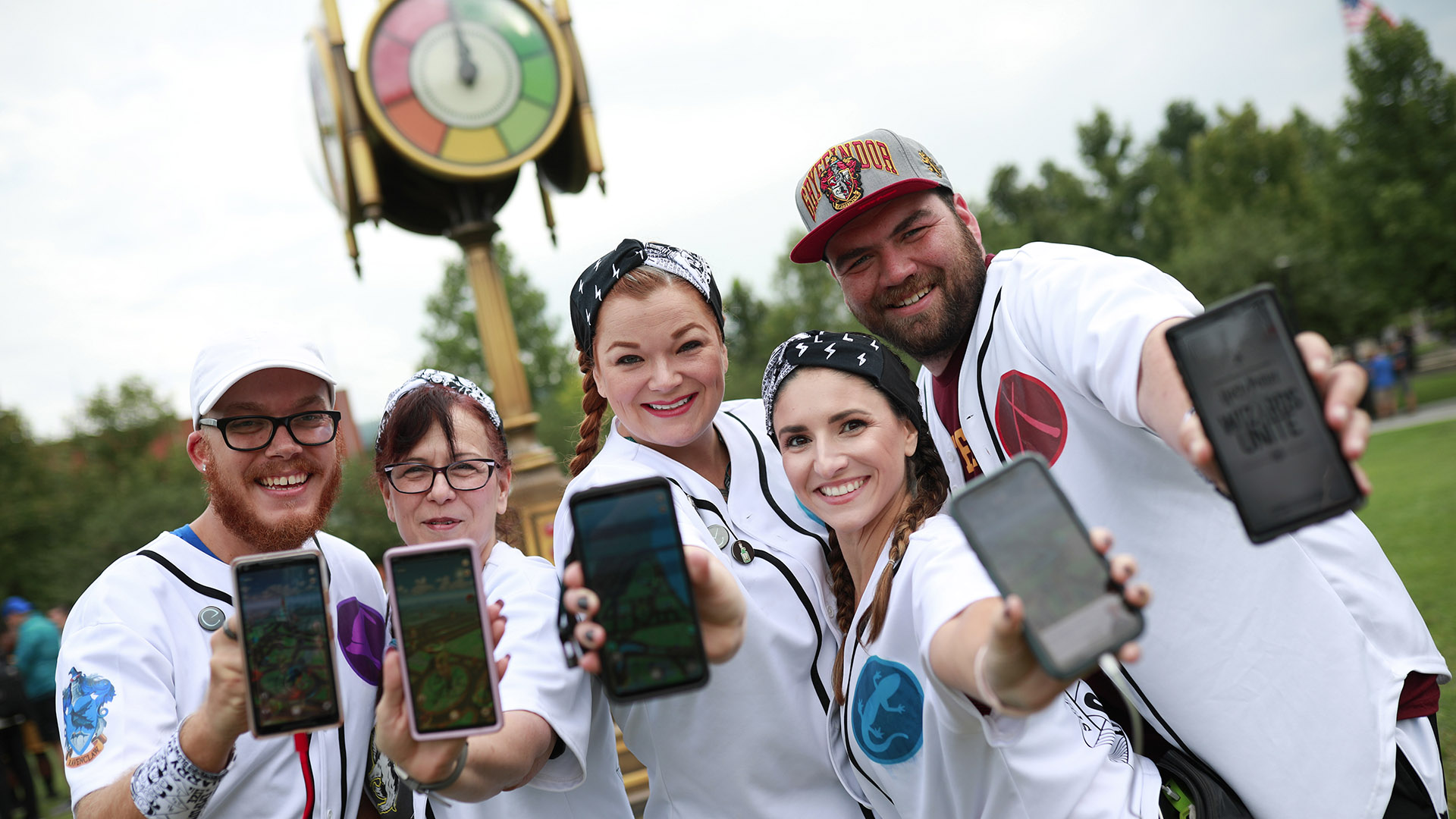 Gamers show off their phones as they hunt for Foundables in White River State Park.