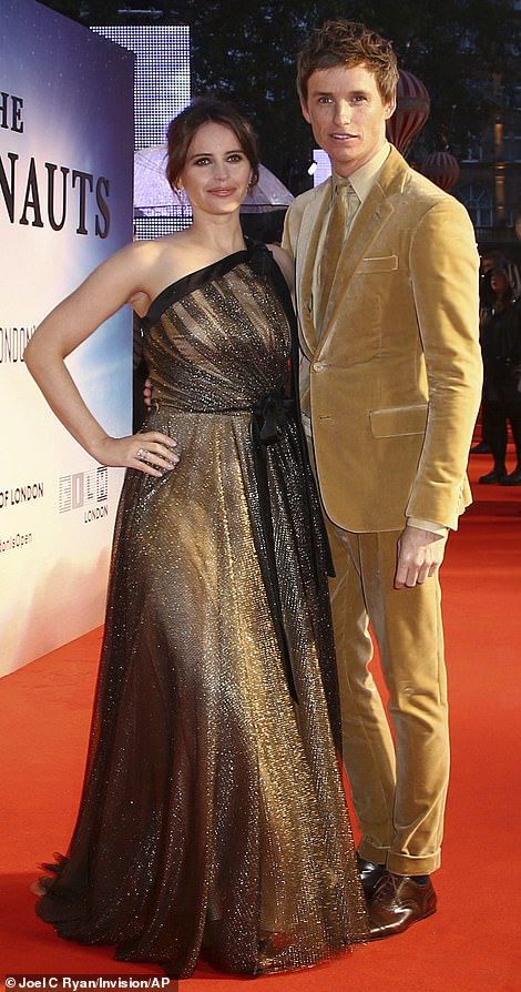 "Eddie Redmayne poses on the red carpet with ""The Aeronauts"" costar Felicity Jones at the London Film Festival."