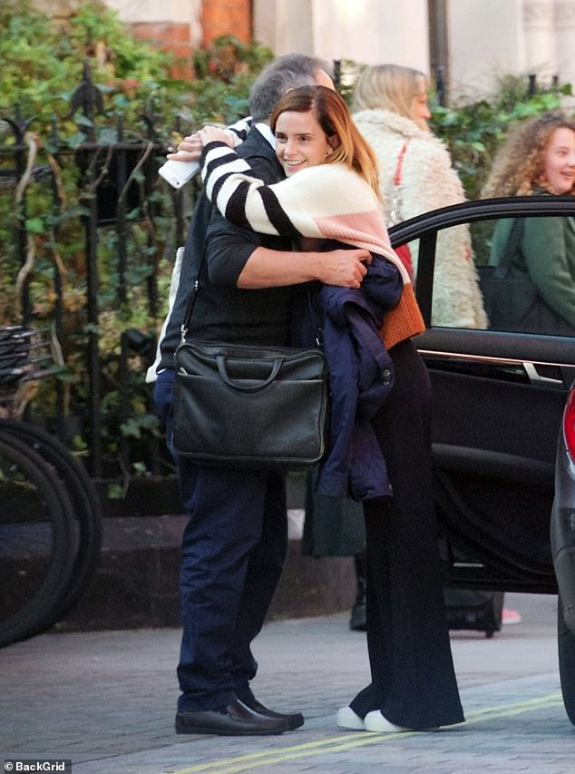 Emma Watson hugs her father, Chris, after lunching in London.
