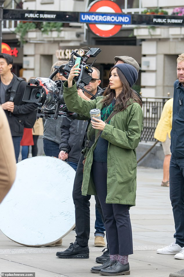 "Gemma Chan is seen filming for ""The Eternals"" in Piccadilly Circus."