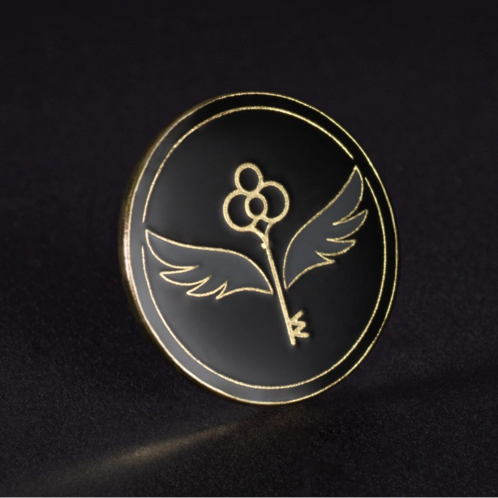 The Gold membership pin features an enchanted key.