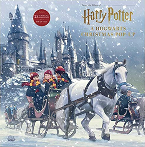 The front cover of this pop-up book has gorgeous artwork of Harry, Ron, and Hermione in front of Hogwarts castle.
