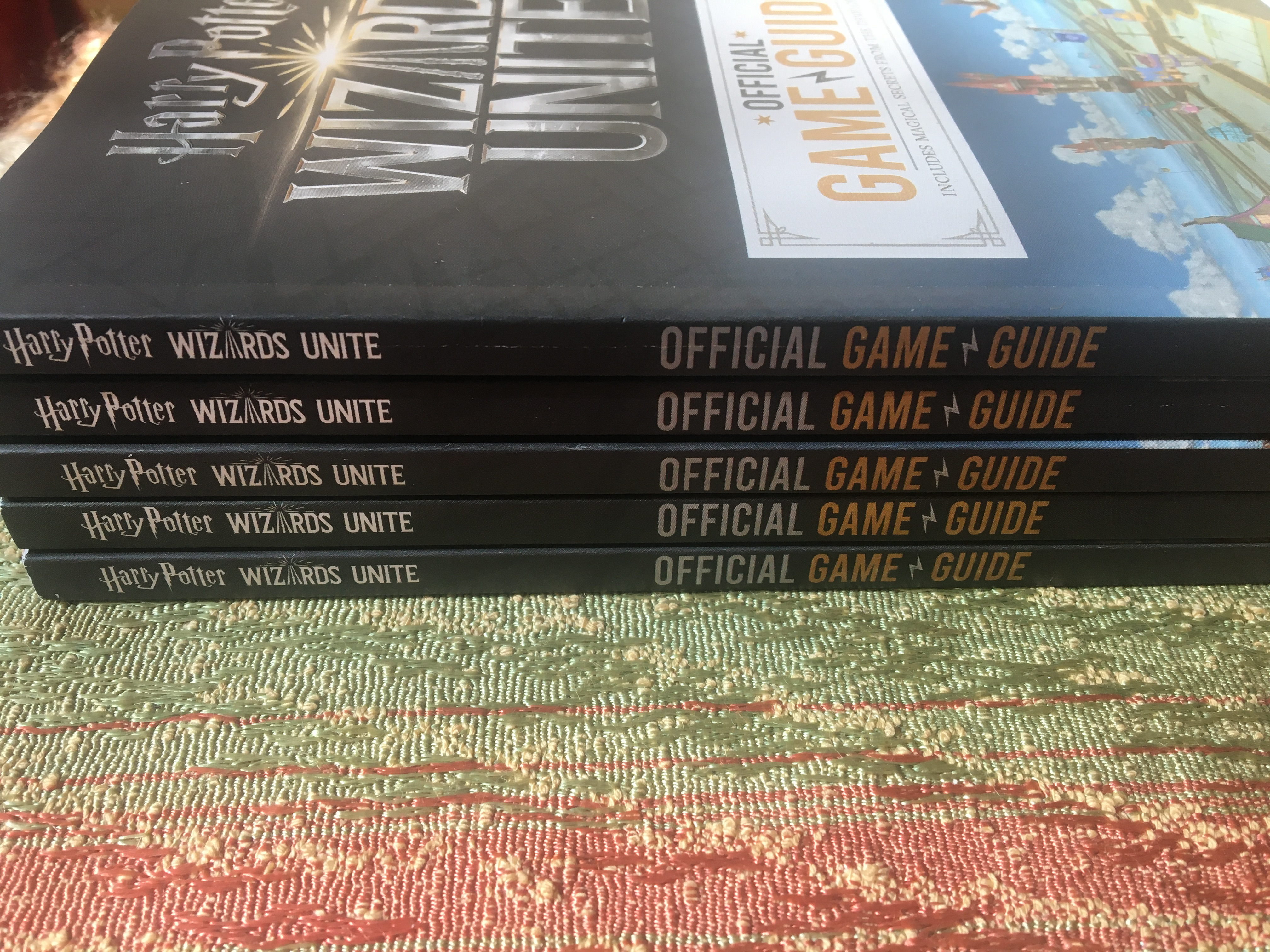 """Harry Potter: Wizards Unite: Official Game Guide"", tilted view of stack"