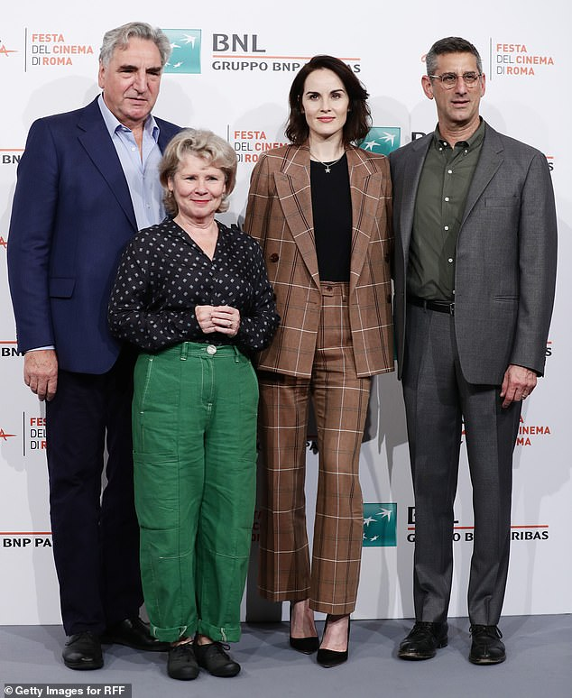 "Imelda Staunton poses during a photocall in Rome with ""Downton Abbey"" costars Jim Carter, Michelle Dockery, and Michael Engler."