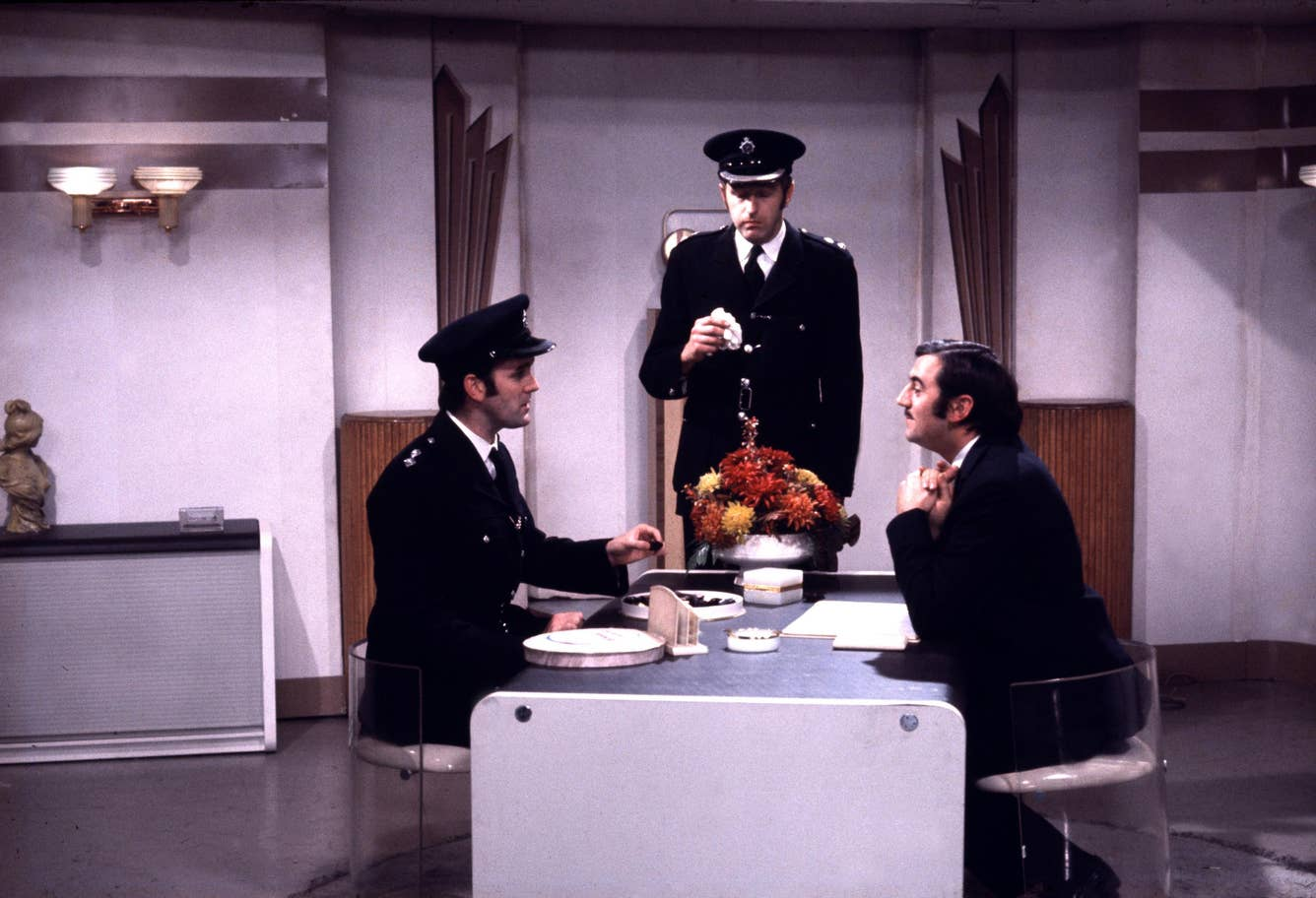 "John Cleese, left, is pictured with Graham Chapman and Terry Jones in the ""Crunchy Frog"" sketch."
