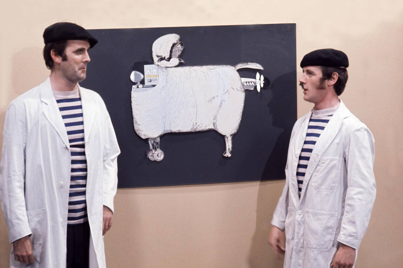 "John Cleese, left, is pictured with Michael Palin in the ""French Lecture on Sheep Aircraft"" sketch."