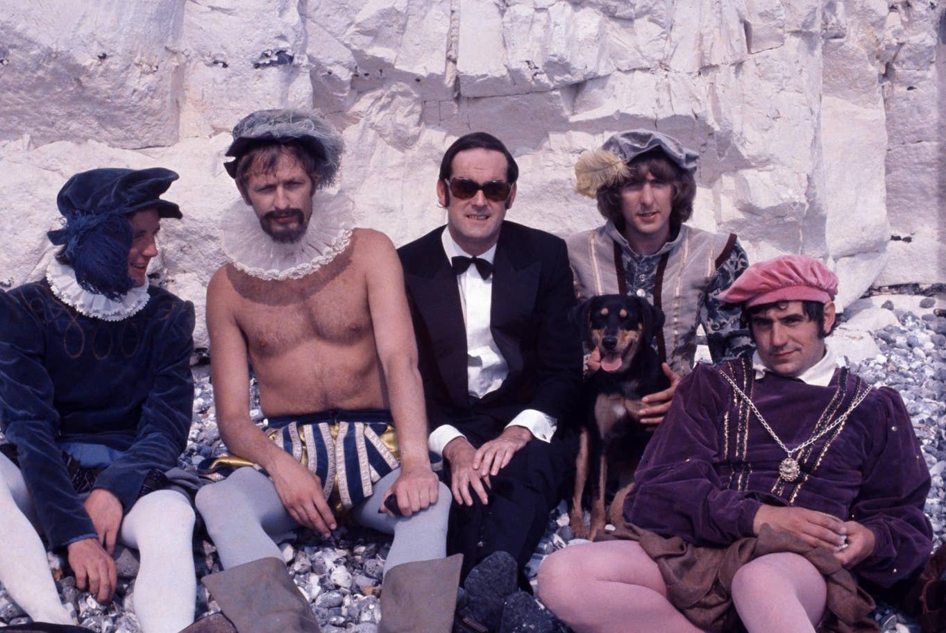 "Michael Palin, Graham Chapman, John Cleese, Eric Idle, and Terry Jones are pictured behind the scenes on the set of ""Monty Python's Flying Circus""."